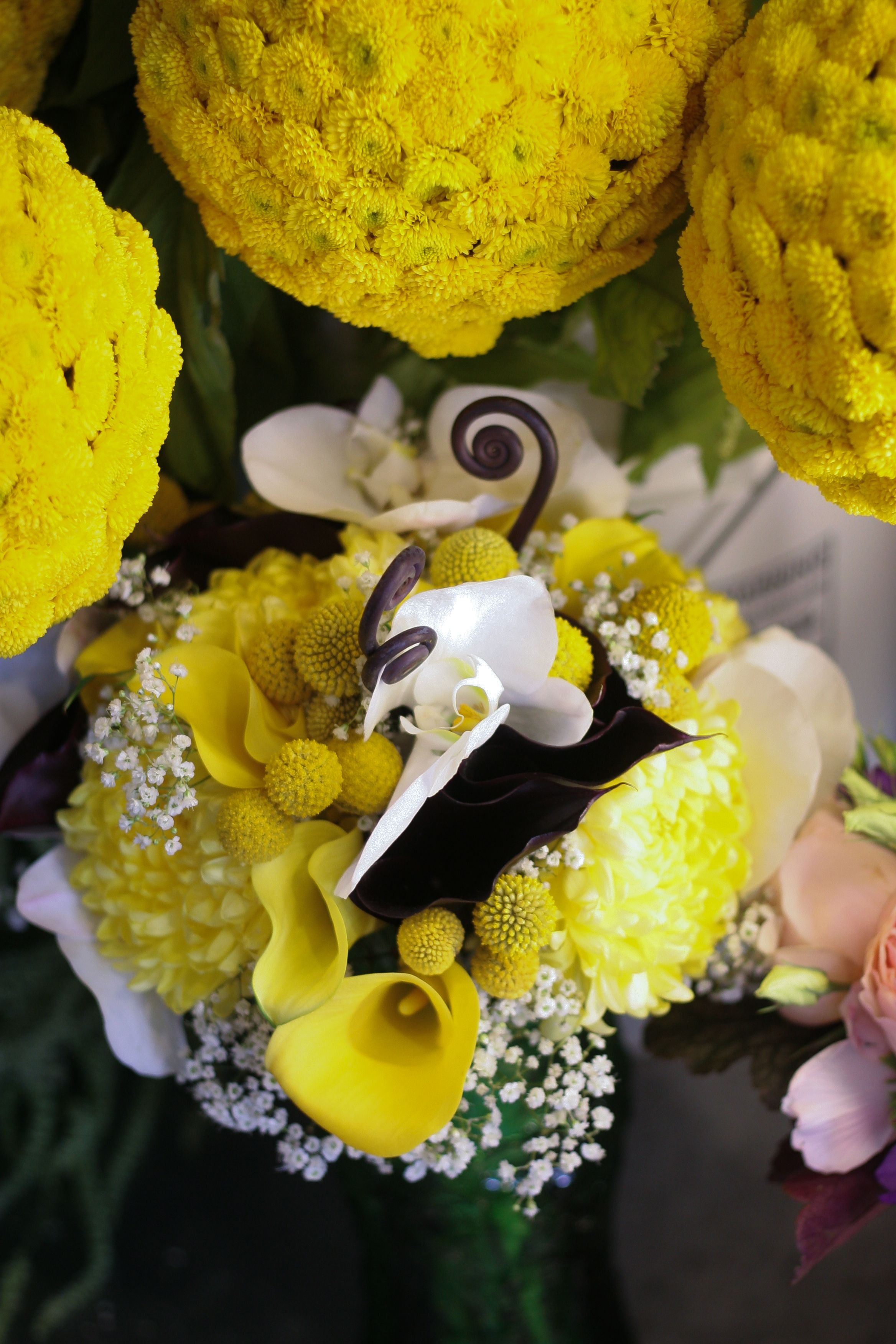 Bouquet and pomander balls by sweet pea flowers denver