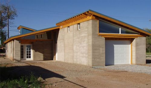 Rammed earth 18 to 24 thick walls compacted with a for Rammed earth home designs