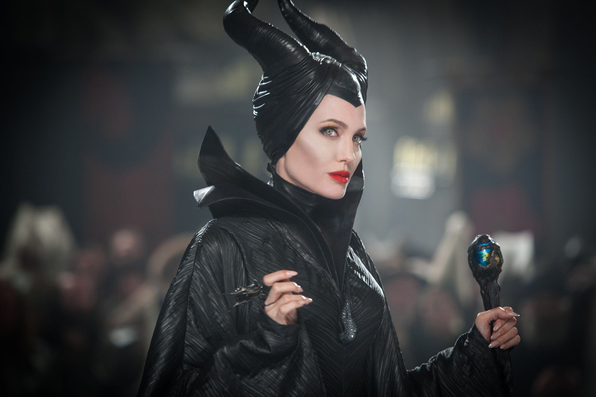 What to wear: A black turtleneck with a cape and big collar. The horns might take some papier-maché, but they're necessary. You need a cool staff, of course.  How to act: Mysterious and just a little evil. Whip out your red-lipsticked smile only to make a point.