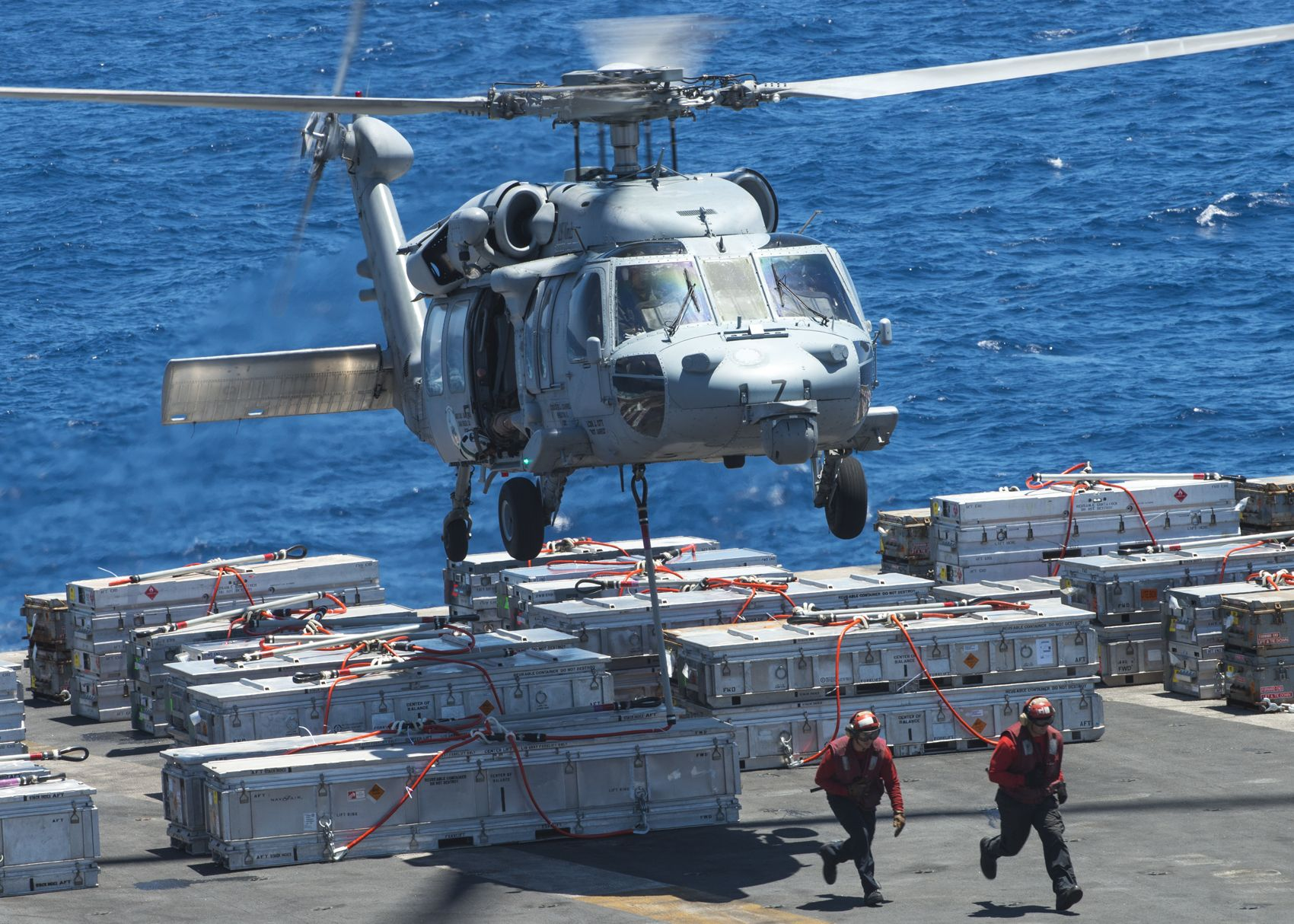 PACIFIC OCEAN (July 8, 2015) An MH-60S Sea Hawk helicopter assigned to the Eightballers of Helicopter Sea Combat Squadron (HSC) 8 lifts an ordnance canister from the aircraft carrier USS Carl Vinson (CVN 70). Carl Vinson is underway performing ammunition off-load. (U.S. Navy Photo by Mass Communication Specialist 3rd Class D'Andre L. Roden/Released)