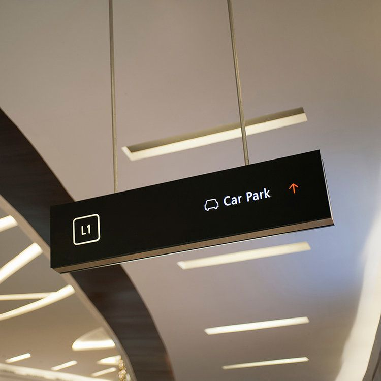 Overhead directional signage in stainless steel and back ...