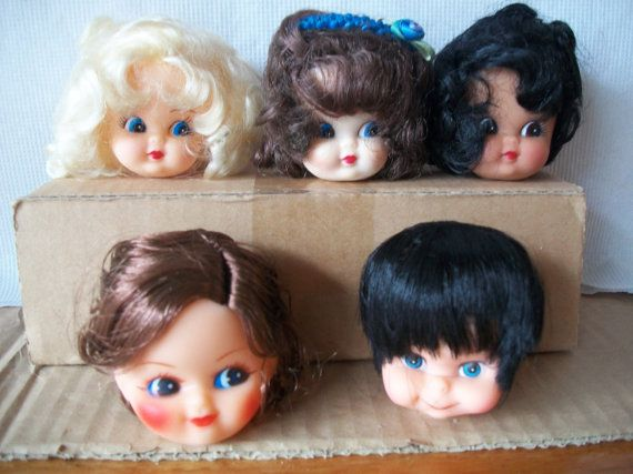 choice of one vintage plastic doll head made in Hong Kong