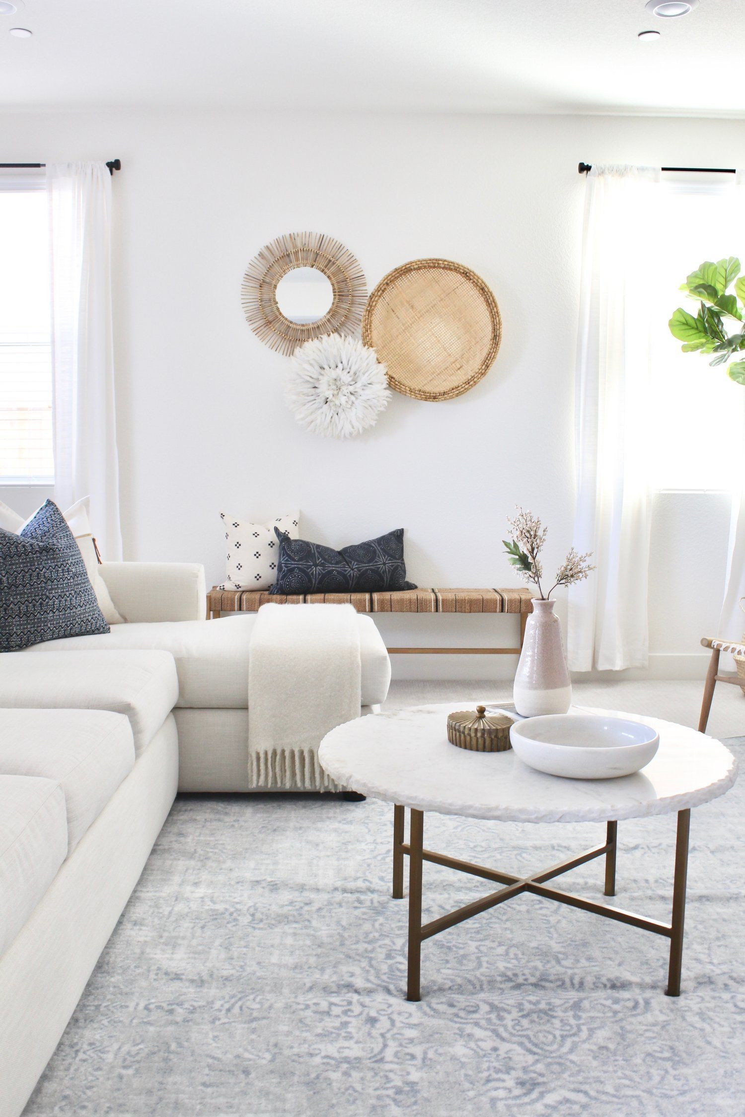 Needing a little home update with extra attention to your home+life needs? Check out our Post Place project living room with modern coastal decor and an airy white couch and walls. #livingroom #whiteinterior #westelm #wall decor living room modern