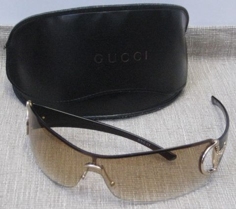 decd951b125 Gucci  2172 S Strass  Sunglasses. Tan wrap around lens with gold horsebit    rhinestone detail. Features chocolate brown arms.