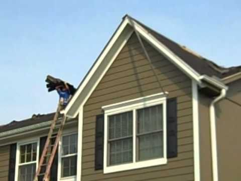 The Removal Of Hail Damaged Shingles And The Installation Of New Lifetime Shingles On An Olathe Ks Home American Roofing Roofing Olathe