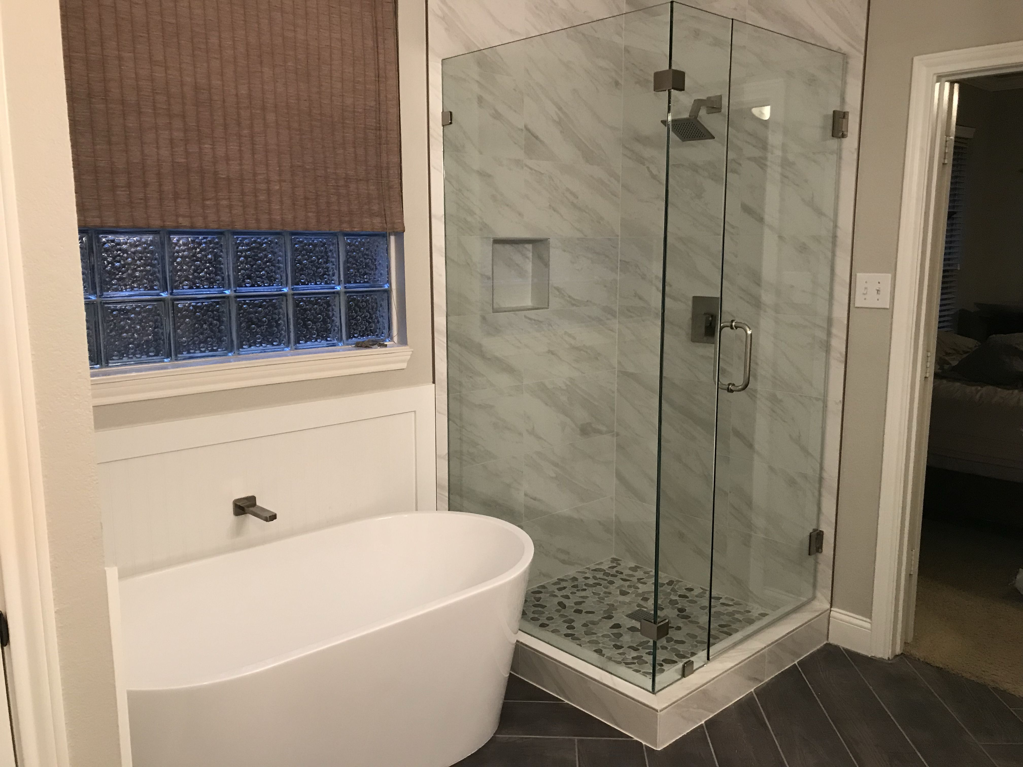 Free Standing Tub Next To Frameless Glass Shower In Master