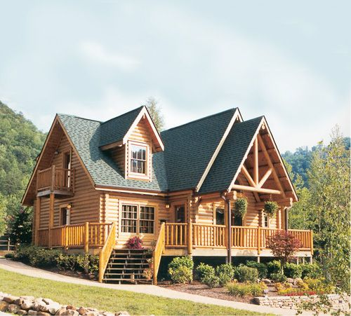 Sitting on the edge of the great smoky mountains this for Full wrap around porch log homes