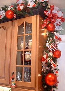 Kitchen Christmas Garland I Love This Idea For Halloween Too Orange And Black With Candy Orna Christmas Kitchen Decor Christmas Garland Christmas Decorations