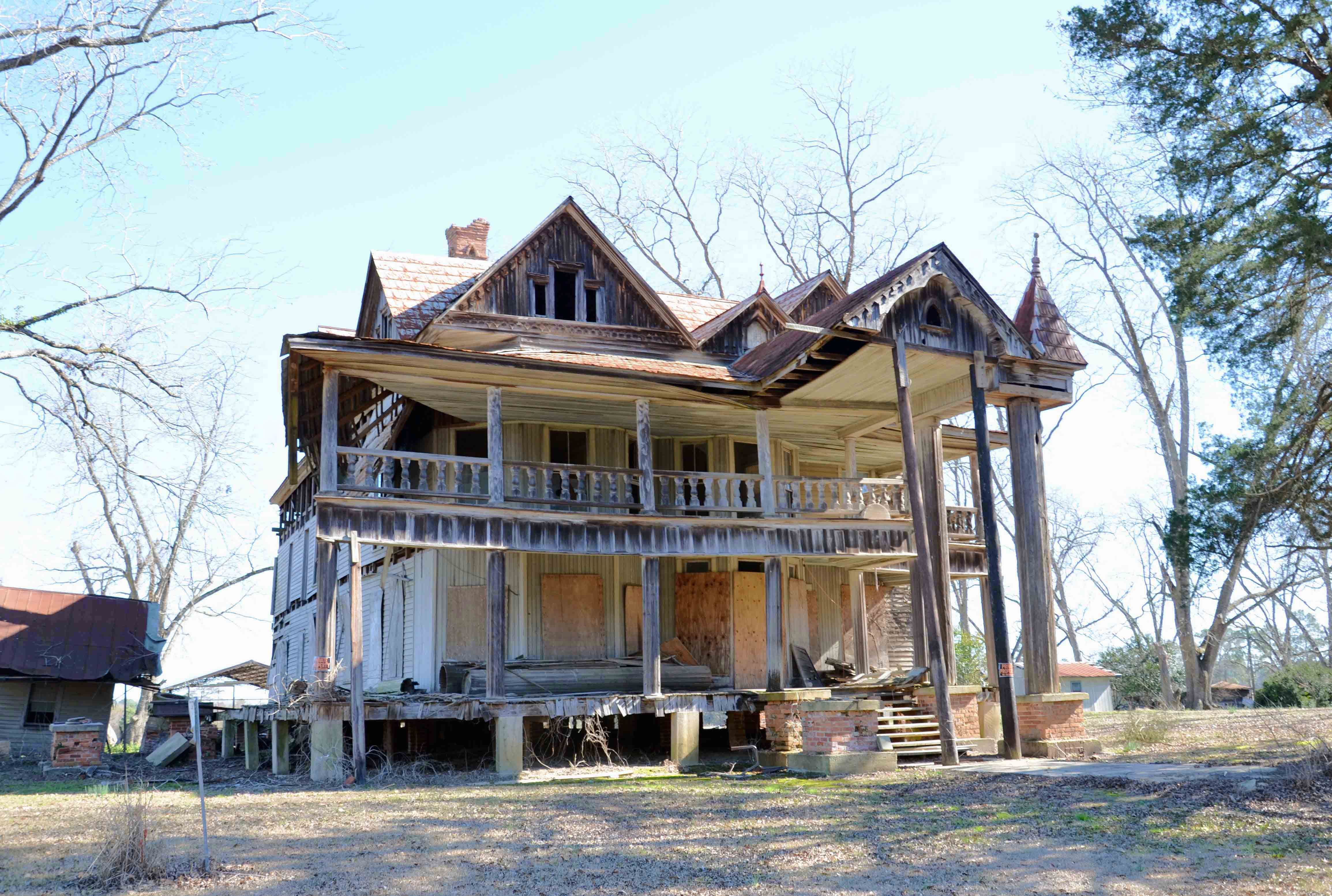 Rumor has it that two old women died in the house and went unnoticed.  Allegedly, a blue light can be seen in the window at night and those who have entered the house have reported seeing the women in their rocking chairs.