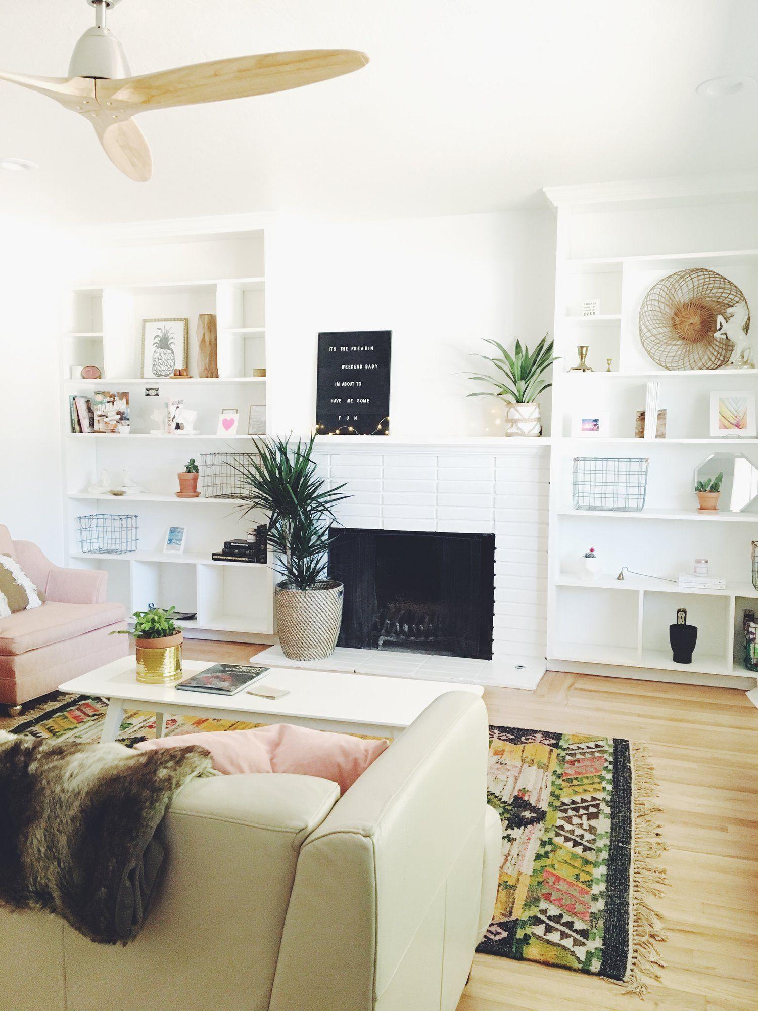 Boho chic living room in a California Air BnB. White Built-ins ...