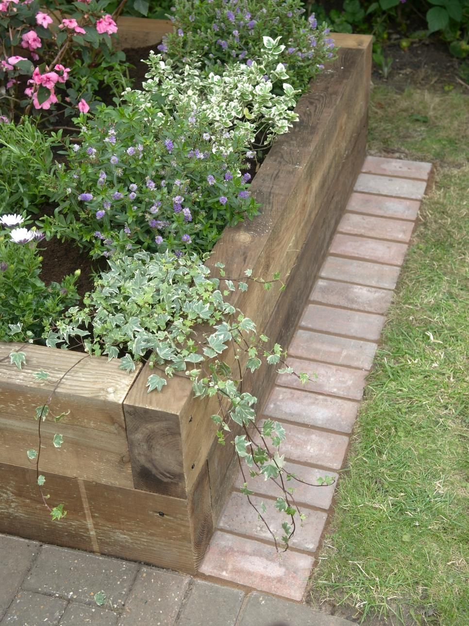 The decorative brick edge on this raised bed garden makes mowing a ...
