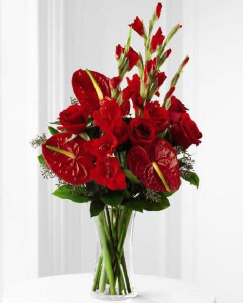 We Fondly Remember Tropical Flower Bouquet Of Assorted Red Roses Anthurium And Gladiola In Va Red Rose Arrangements Tropical Flowers Bouquet Anthurium Bouquet