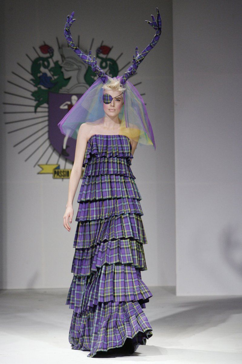 Cascading purple plaid pleats. Ditch the headpiece, though ...