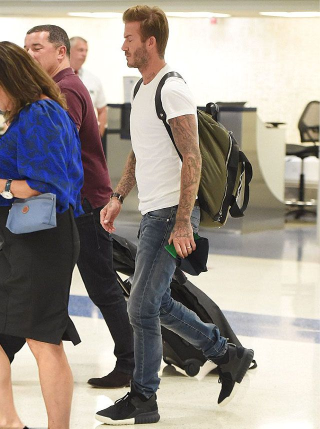 David Beckham wears Adidas originals Tubular Sand Givenchy Backpack at JFK airport #davidbeckham #adidasoriginals #sneakers #tubularsneakers #givenchy #backpack #newyork #jfk