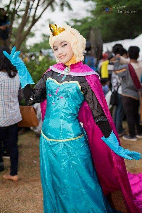 Elsa cosplayer plays with herself in the snow