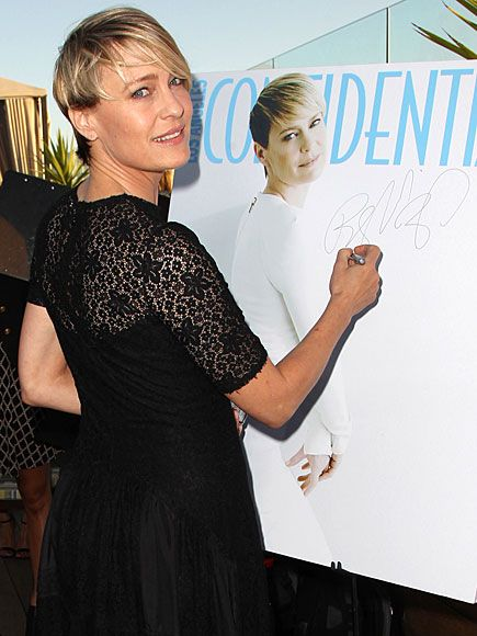 Star Tracks: Friday, June 6, 2014   SEEING DOUBLE   Hey, that's me! Robin Wright shows off her signature style signing Los Angeles Confidential's Women of Influence issue, of which she graces the cover, in Beverly Hills on Wednesday.