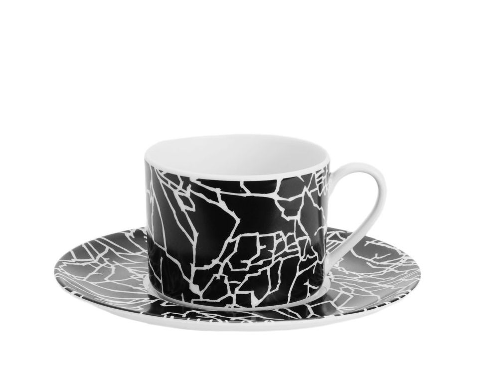KELLY WEARSTLER | TRACERY WHITE ON BLACK TEA CUP & SAUCER. Chic casual china.