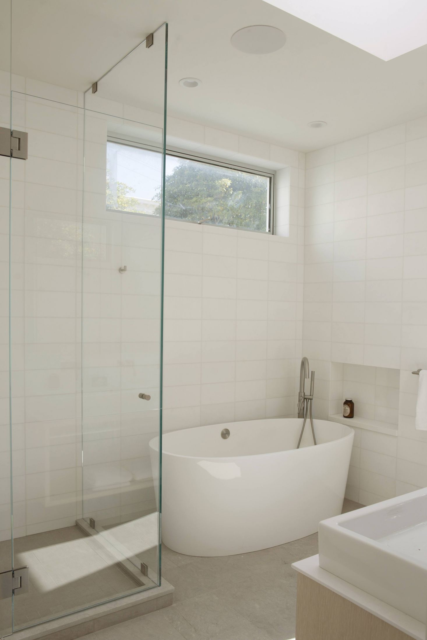 Each master bath has radiant underfloor heating with white ceramic ...