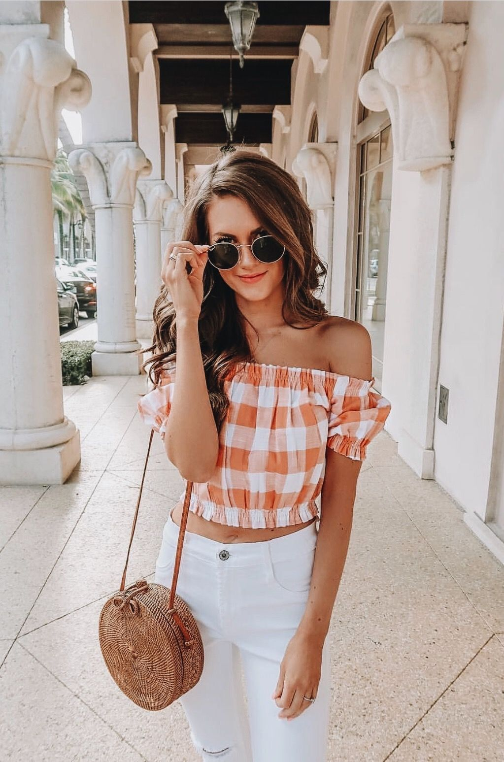 0707bb662d Cute off the shoulder orange and white checked top with white jeans ...