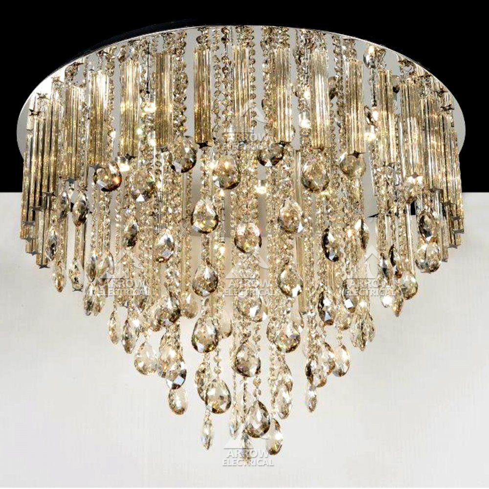 Light from 12x 20w g4 lamps and 9x 3w leds shines through multi decorative 21 light crystal chandelier in gold at arrow electrical arubaitofo Images