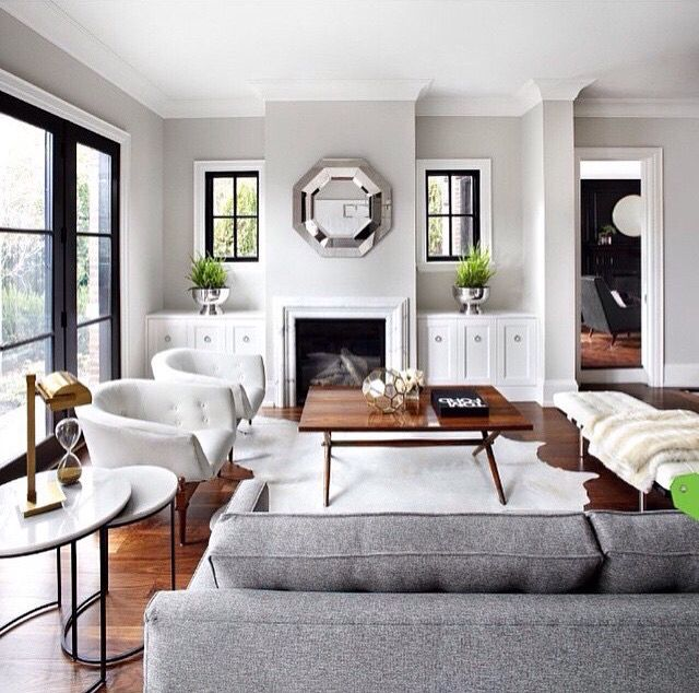 Gray Couch White Chairs Black Doors Touch Of Green Living Room Grey Living Room Designs Grey Interior Design