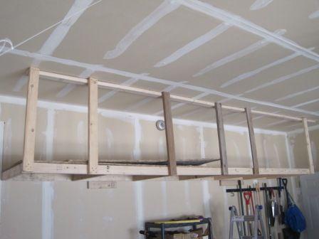 overhead hanging storage slide floor boards on garage management rh pinterest com Garage Shelving Garage Shelving