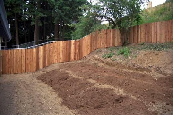 Wood Fence On A Hill Diy Fence Installation Tips The