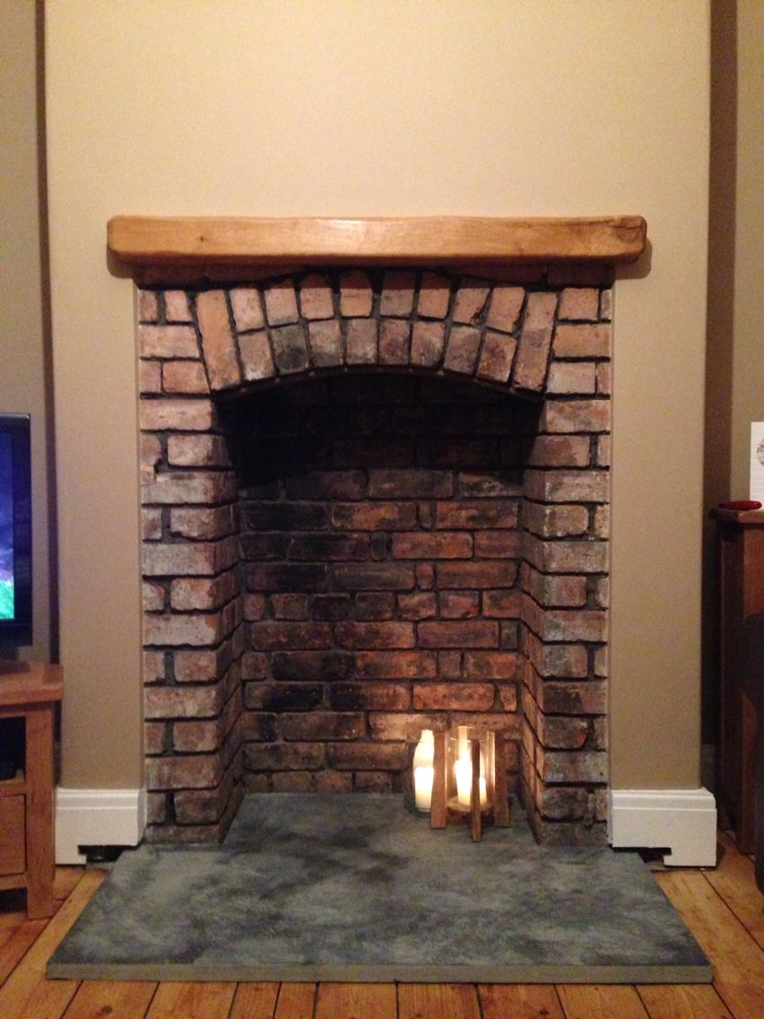 Image result for wood burning stove in brick fireplace living room