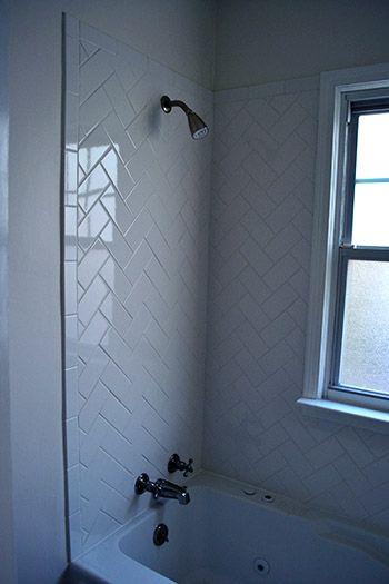 Nice Alternative For The Subway Tiles Who Doesn T Love A Good Herringbone Herringbone Subway Tile Tile Tub Surround Bathroom Makeover