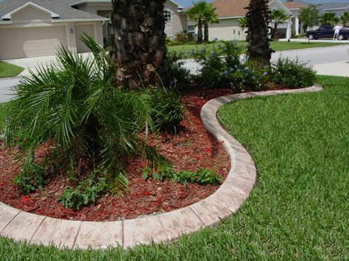Kwik kerb eurostyle stamped and colored concrete curbing for Decorative garden edging ideas