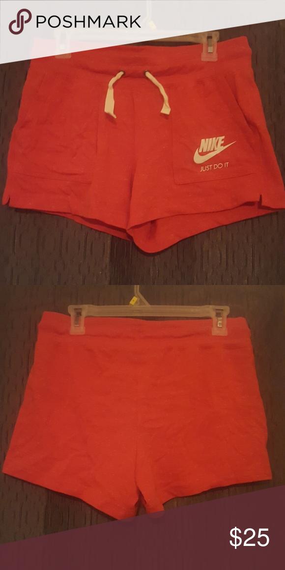 buy online a87dd d33af Nike sweat shorts Orange nike shorts with speaks of white. Nike Shorts