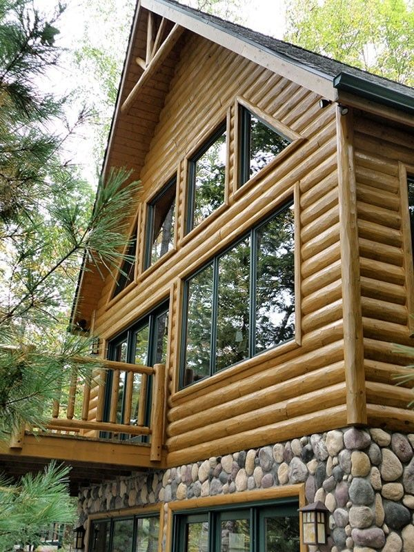 Half Log Hewn Siding With A Cedar Railing Around The Deck Log Cabin Exterior Log Homes Log Siding