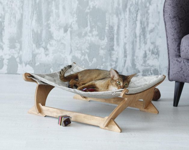 Cat hammock, Ergonomic pet bed made of plywood and cavas. This cat hammock will fit to your cat's shape and give them ultimate comfort - a unique product by CatPlayFurniture. Via en.DaWanda.com.
