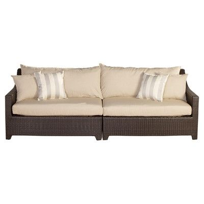 We have an outdoor sofa like this and love the woven texture and the not white but not too dark cushions. They go with everything and it's holding up really well.
