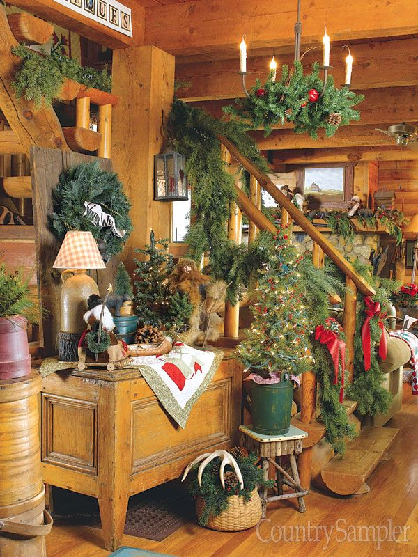 get a great lodge look by decorating with antlers plaid and log themed accessories and bringing in lots of greenery to punctuate all the wood tones