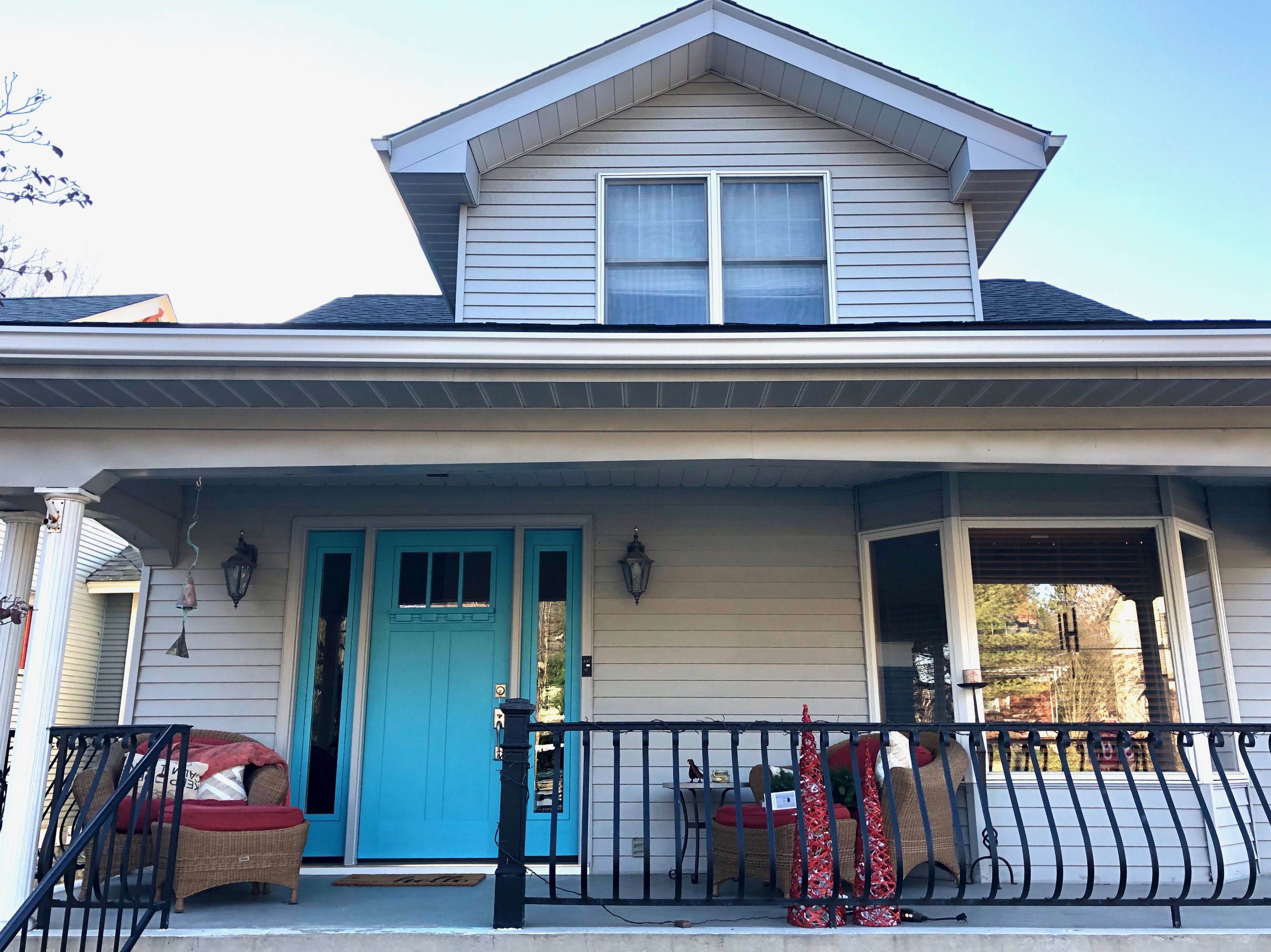 New turquoise door adds instant curb appeal to this