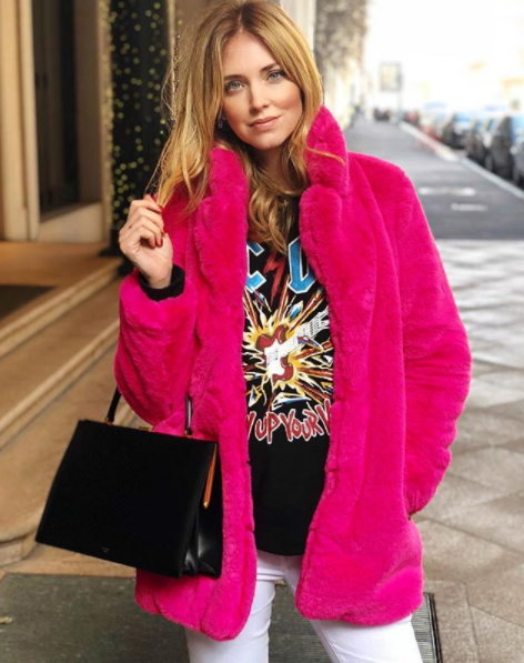 Chiara Ferragni wears a black AC DC print sweatshirt by Gucci and a pink  coat by Majorelle 12ed54eba04