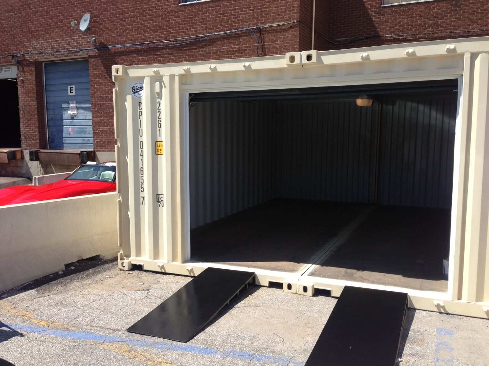 We ve modified two new 20 shipping containers into a 20 for Garage modification