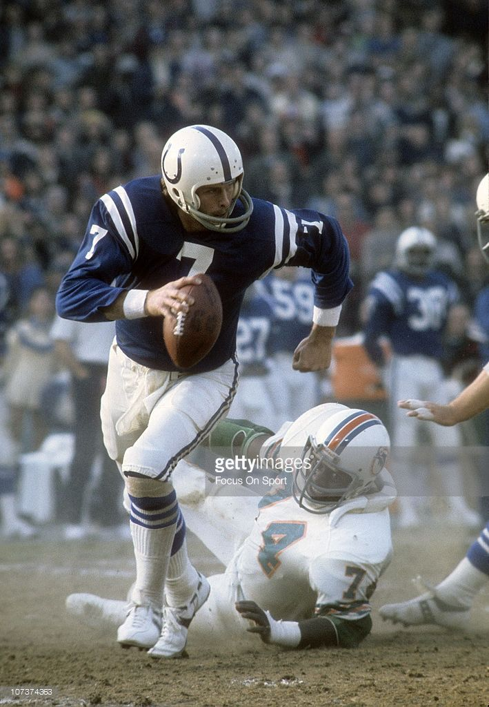 Bert Jones eludes the pass rush of the Dolphins, 1975