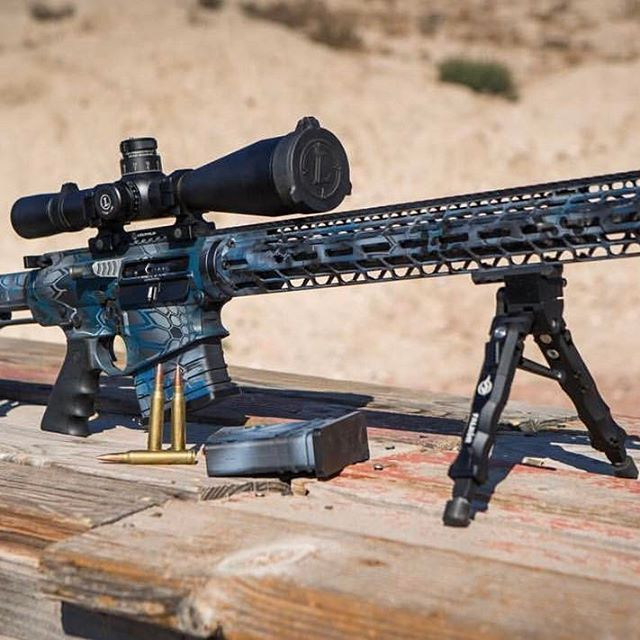 Long range perfected. A look at @jim_thekraken_erwin personal Petra custom painted by @elyyerian equipped with a @proof_research Carbon Fiber Barrel and @leupoldoptics MK8. #rifle #gun #precision