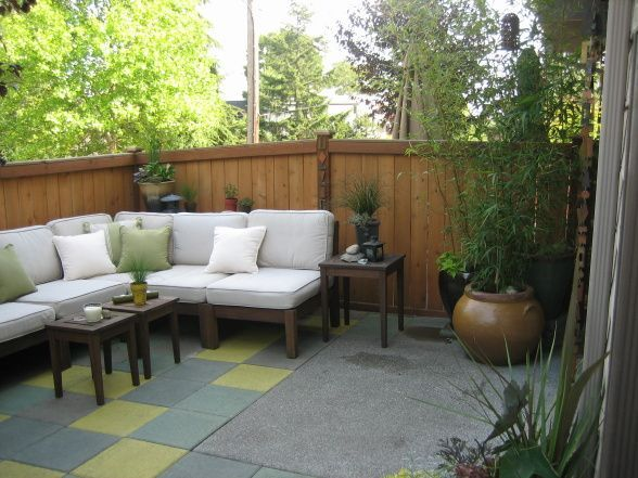 Lovely Patio Oasis, Small Townhouse Backyard Turned Into An Outdoor Living Space  Using Custom Stained Cement