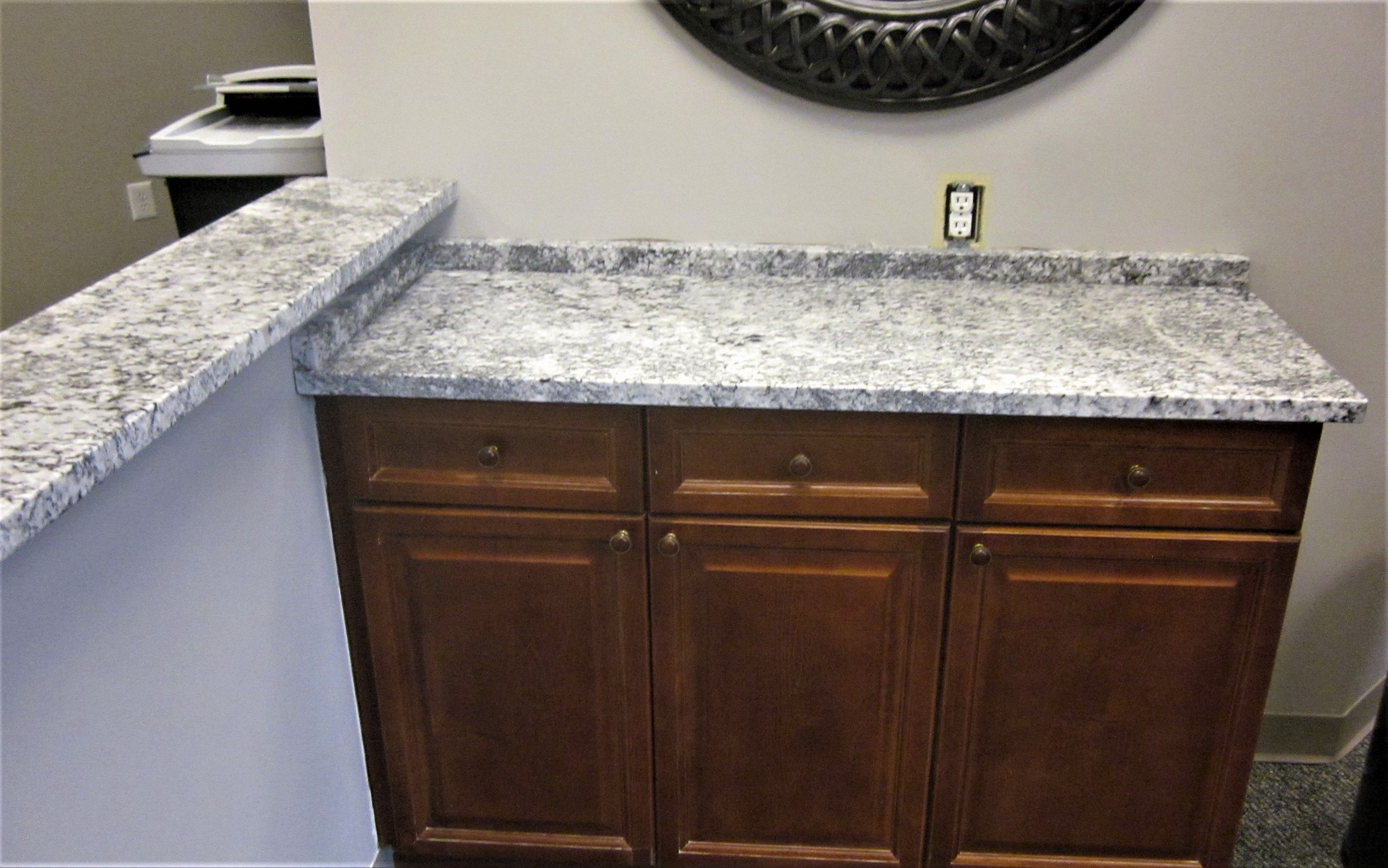 Blizzard Granite Dark Hardwood Cabinets White Walls Stone