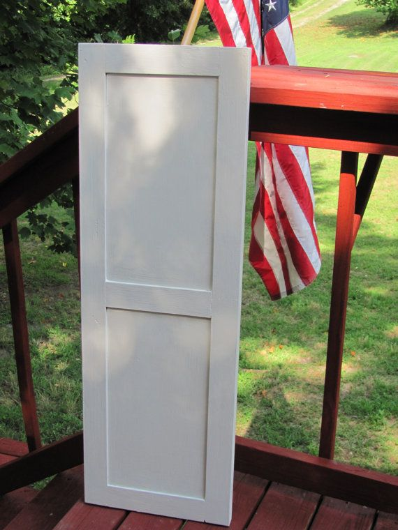 Flat Panel Shutters with Bead Trim featuring a 204040 split