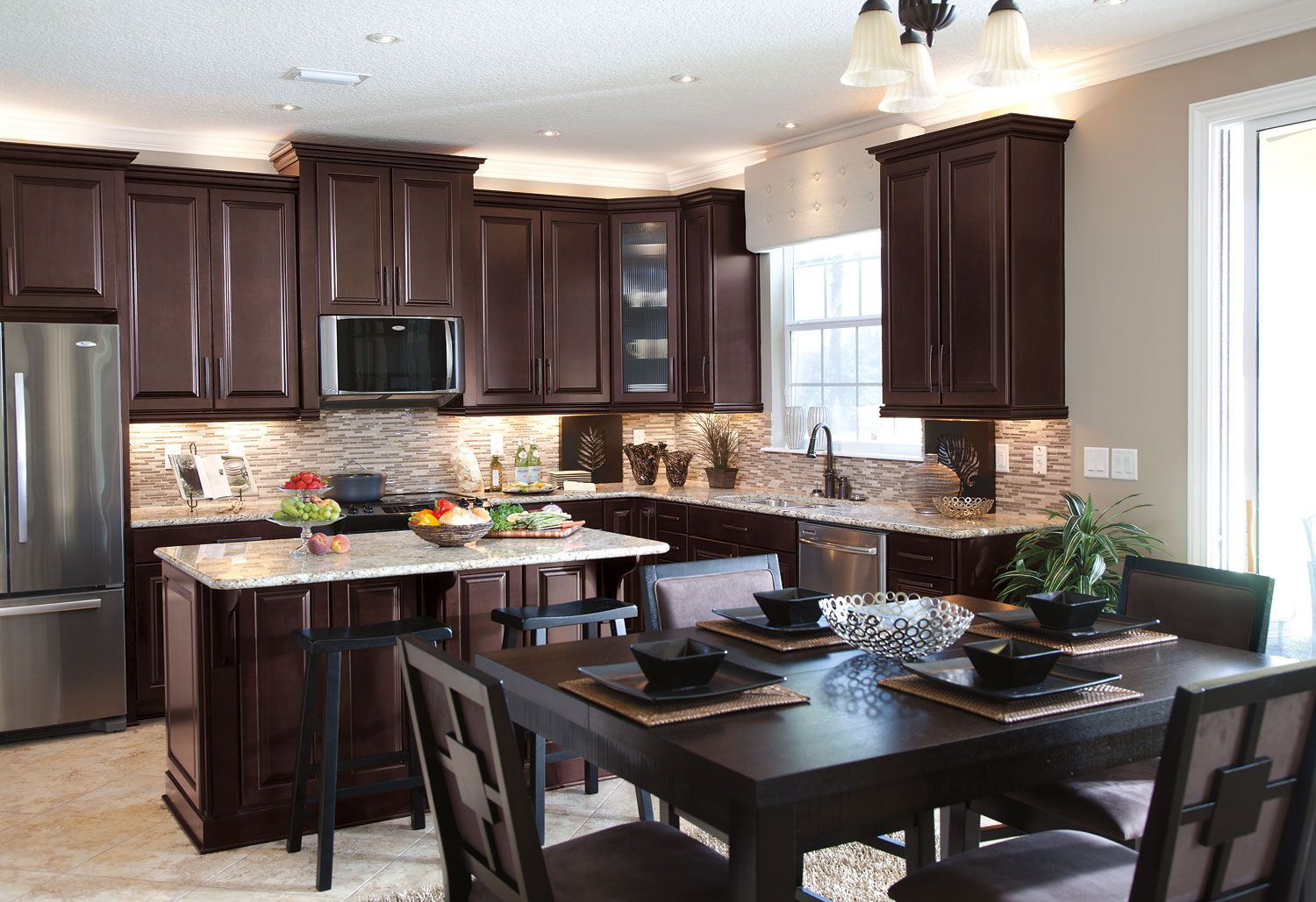 Timberlake Cabinets With Light Rail Lighting And Crown Molding Accent Interio Dark Brown Kitchen Cabinets Brown Kitchen Cabinets Cherry Wood Kitchen Cabinets
