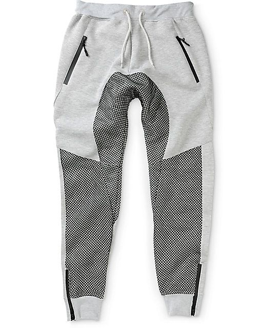 e4ec8b0acb Add a unique jogger look to your collection with a black mesh leg and drop  crotch overlay on a heather grey terry construction with two waterproof  zipper ...