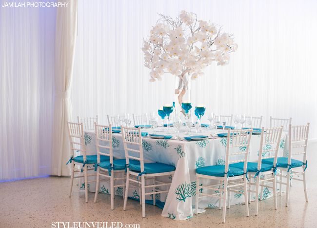 Turquoise And White Wedding Table Decor / J Morgan Flowers / Jamilah  Photography / Via StyleUnveiled