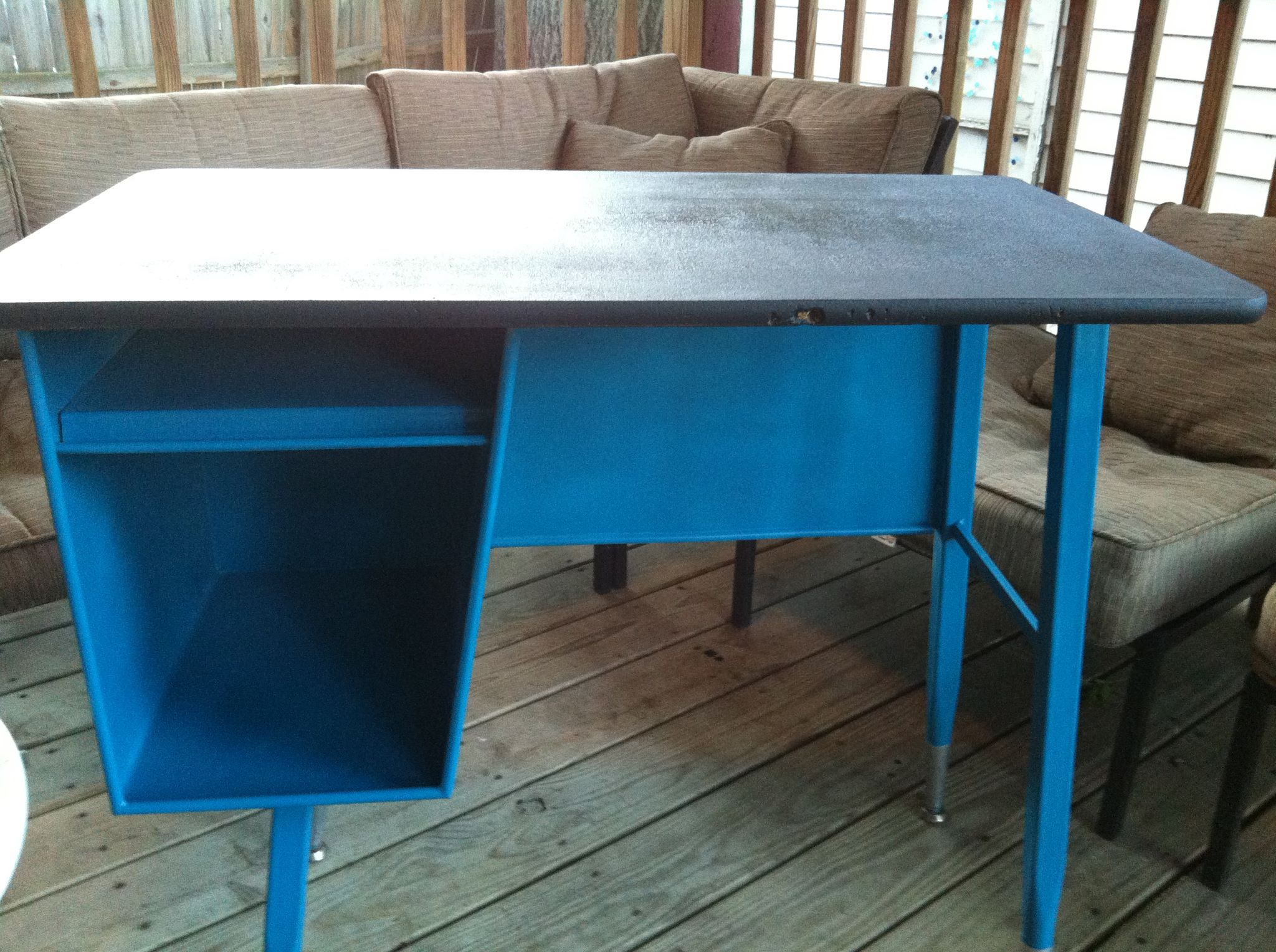 Antique school desk painted peacock blue with a chalkboard