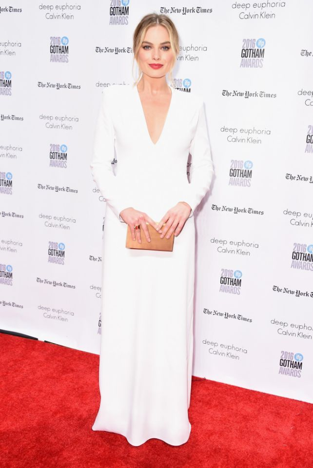 bd4be88327456 ... in a long-sleeved white Calvin Klein Collection gown with a plunging  neckline at the 26th Annual Gotham Independent Film Awards in New York City.