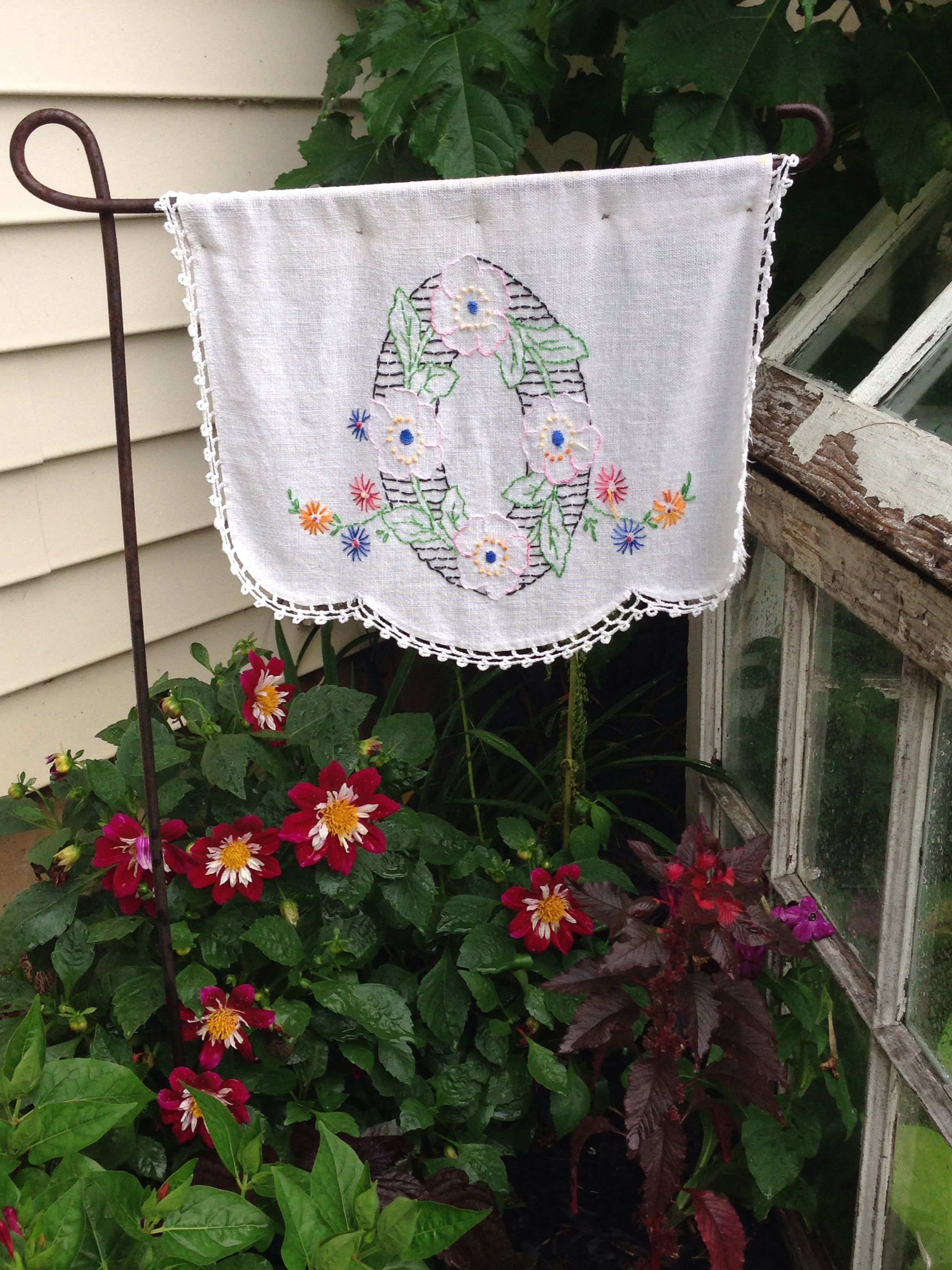 DIY Garden Flag made from a vintage doily...a simple way to add charm to your Summer garden!