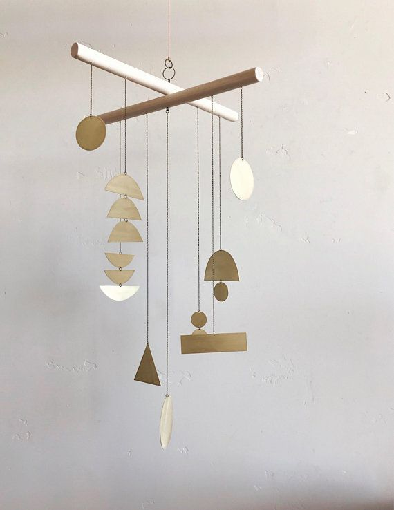 10 Modern Wind Chimes And Mobiles That Sway With Sophistication Modern Wind Chimes Wind Chimes Geometric Baby Mobile